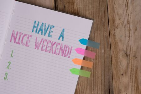 Text sign showing Have A Nice Weekend. Business photo text wishing someone that something nice happen holiday Striped note book four colored arrow banners reminder wooden background Banque d'images - 128687777