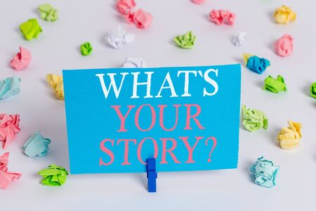 Writing note showing What S Your Story Question. Business concept for asking demonstrating about his past life actions career or events Colored crumpled paper empty reminder white floor clothespin Imagens