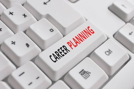 Writing note showing Career Planning. Business concept for Strategically plan your career goals and work success White pc keyboard with note paper above the white background 写真素材
