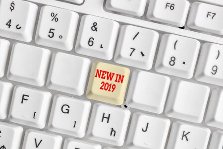 Conceptual hand writing showing New In 2019. Concept meaning what will be expecting or new creation for the year 2019 White pc keyboard with note paper above the white background