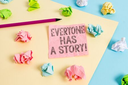 Conceptual hand writing showing Everyone Has A Story. Concept meaning account of past events in someones life or career Colored crumpled papers empty reminder blue yellow clothespin
