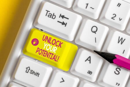 Text sign showing Unlock Your Potential. Business photo showcasing release possibilities Education and good training is key White pc keyboard with empty note paper above white background key copy space