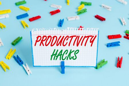 Text sign showing Productivity Hacks. Business photo showcasing tricks that you get more done in the same amount of time Colored clothespin papers empty reminder blue floor background office pin