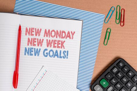 Word writing text New Monday New Week New Goals. Business photo showcasing goodbye weekend starting fresh goals targets Striped paperboard notebook cardboard office study supplies chart paper