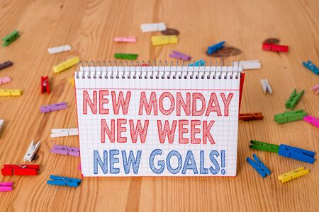 Handwriting text writing New Monday New Week New Goals. Conceptual photo goodbye weekend starting fresh goals targets Colored clothespin papers empty reminder wooden floor background office Imagens