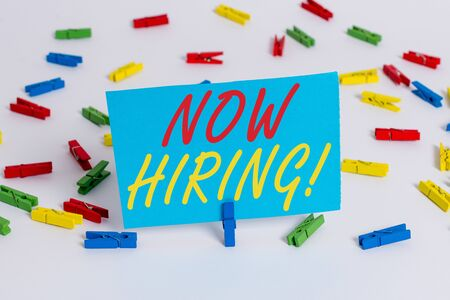 Text sign showing Now Hiring. Business photo text finding evaluating working relationship with future employees Colored clothespin papers empty reminder white floor background office Zdjęcie Seryjne