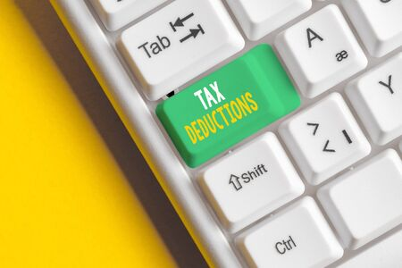 Word writing text Tax Deductions. Business photo showcasing an amount or cost that subtracted from someone s is income White pc keyboard with empty note paper above white background key copy space