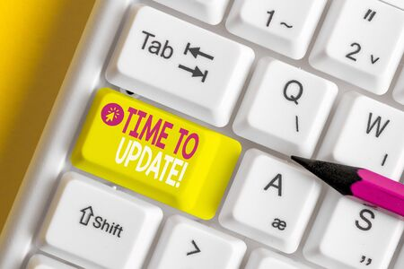 Text sign showing Time To Update. Business photo showcasing this is right moment to make something more modern new White pc keyboard with empty note paper above white background key copy space