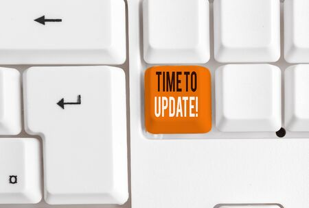 Writing note showing Time To Update. Business concept for this is right moment to make something more modern new White pc keyboard with note paper above the white background