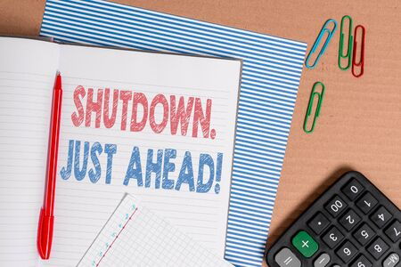 Word writing text Shutdown Just Ahead. Business photo showcasing closing factory business either short time or forever Striped paperboard notebook cardboard office study supplies chart paper