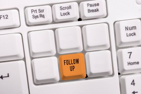 Conceptual hand writing showing Follow Up. Concept meaning a continuation of something that has already been started White pc keyboard with note paper above the white background