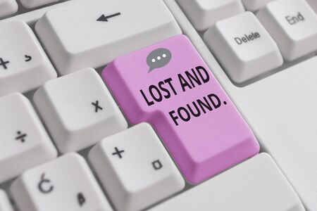 Handwriting text writing Lost And Found. Conceptual photo a place where lost items are stored until they reclaimed White pc keyboard with empty note paper above white background key copy space Фото со стока
