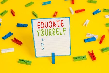 Handwriting text Educate Yourself. Conceptual photo prepare oneself or someone in a particular area or subject Colored clothespin papers empty reminder yellow floor background office