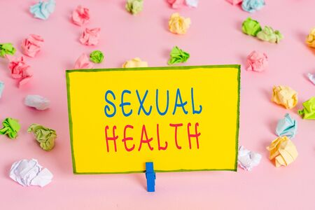 Word writing text Sexual Health. Business photo showcasing positive and respectful approach to sexual relationships Colored crumpled papers empty reminder pink floor background clothespin