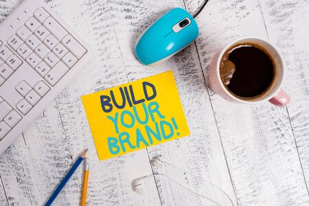 Conceptual hand writing showing Build Your Brand. Concept meaning creates or improves customers knowledge and opinions of product Technological devices colored reminder paper office supplies