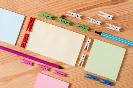 Colored clothespin papers empty reminder wooden floor background office