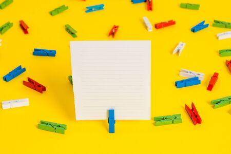 Colored clothespin papers empty reminder yellow floor background office