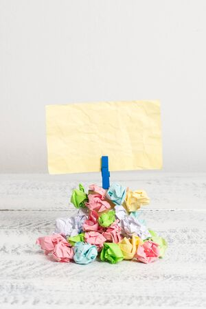 Reminder pile colored crumpled paper clothespin reminder white wooden space Stockfoto