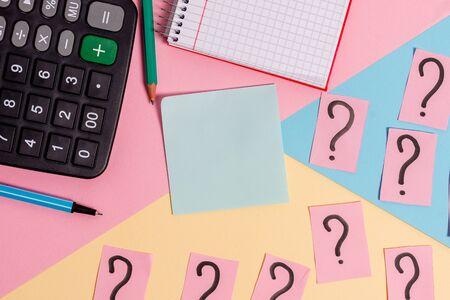 Mathematics stuff and writing equipment above pastel colours background