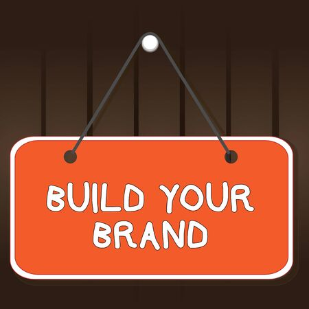 Writing note showing Build Your Brand. Business concept for enhancing brand equity using advertising campaigns Memo reminder empty board attached background rectangle
