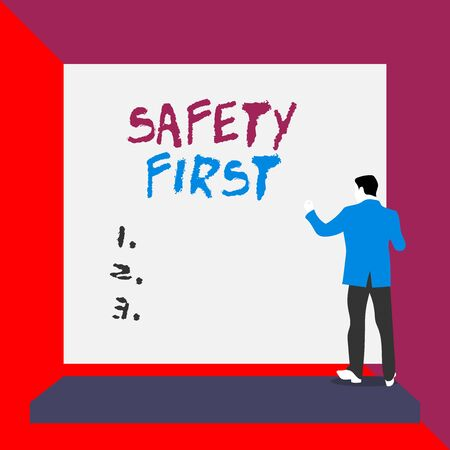 Word writing text Safety First. Business photo showcasing used to say that the most important thing is to be safe Back view young man dressed suit standing platform facing blank rectangle