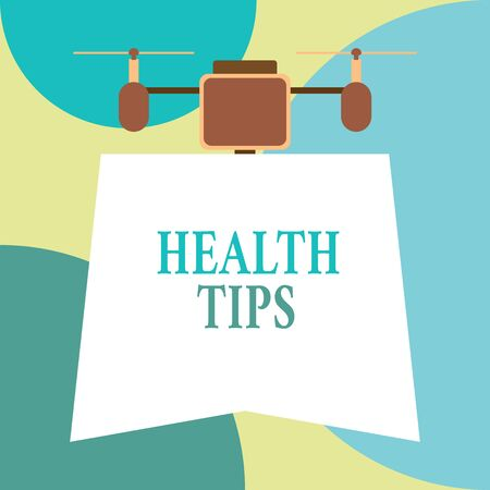Conceptual hand writing showing Health Tips. Concept meaning advice or information given to be helpful in being healthy Drone holding downwards banner. Geometrical design