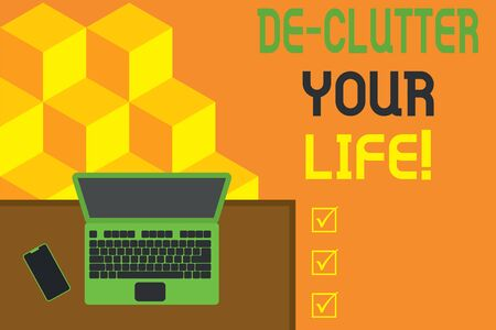 Conceptual hand writing showing De Clutter Your Life. Concept meaning remove unnecessary items from untidy or overcrowded places Office working place laptop lying wooden desk smartphone