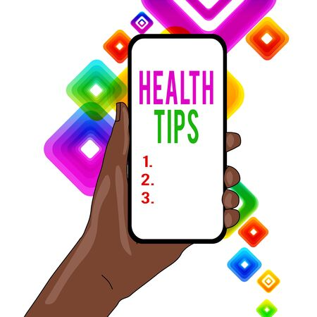 Writing note showing Health Tips. Business concept for advice or information given to be helpful in being healthy Closeup of Smartphone Device Held in Hand and Text Space