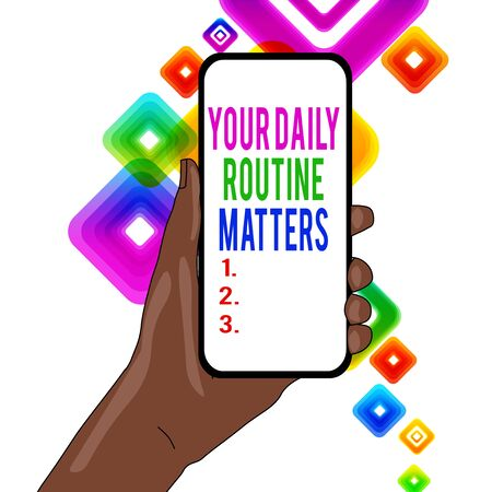 Writing note showing Your Daily Routine Matters. Business concept for practice of regularly doing things in fixed order Closeup of Smartphone Device Held in Hand and Text Space Stockfoto