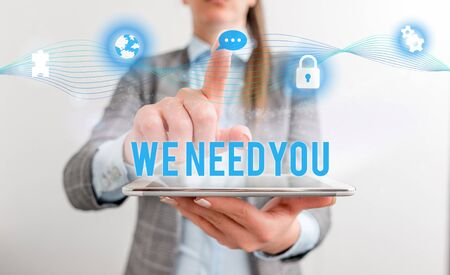Conceptual hand writing showing We Need You. Concept meaning to fulfill the needs of the assignment duty or obligation Female human wear formal work suit presenting smart device