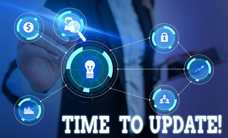 Writing note showing Time To Update. Business concept for this is right moment to make something more modern new Woman wear formal work suit presenting presentation using smart device