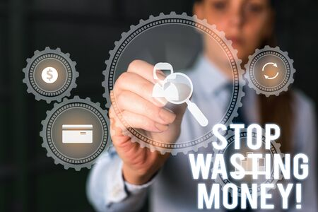 Word writing text Stop Wasting Money. Business photo showcasing advicing demonstrating or group to start saving and use it wisely Woman wear formal work suit presenting presentation using smart device Stockfoto