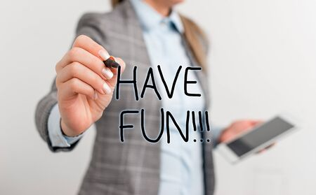 Text sign showing Have Fun. Business photo text wish somebody good and enjoyable time when they do something Business woman pointing in empty space with pen and mobile phone