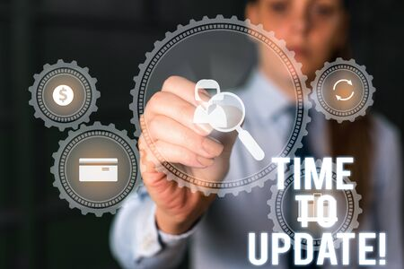 Word writing text Time To Update. Business photo showcasing this is right moment to make something more modern new Woman wear formal work suit presenting presentation using smart device