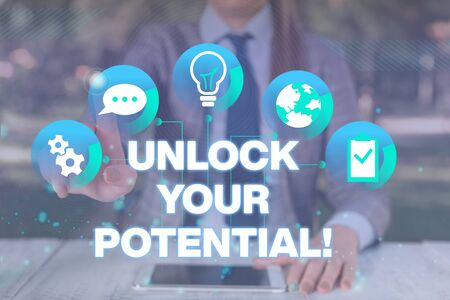 Text sign showing Unlock Your Potential. Business photo showcasing release possibilities Education and good training is key Female human wear formal work suit presenting presentation use smart device