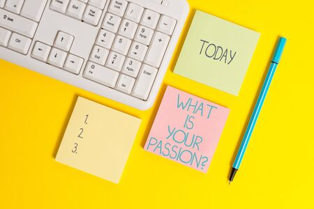 Text sign showing What Is Your Passion Question. Business photo showcasing asking about his strong and barely controllable emotion Empty papers with copy space on the yellow background table Stock fotó