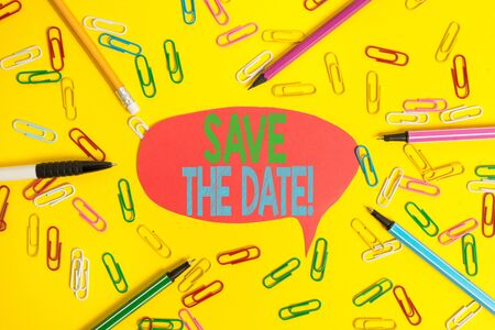 Word writing text Save The Date. Business photo showcasing remember not schedule anything else on this day Flat lay above empty paper with copy space pencils and colored paper clips