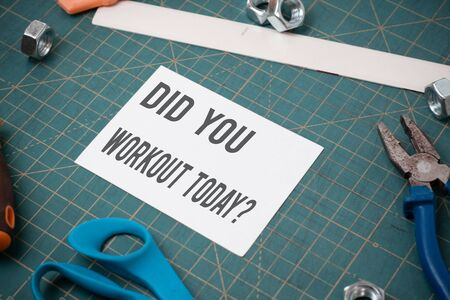 Writing note showing Did You Workout Today. Business concept for asking if made session physical exercise Stationary and carpentry tools with paper above a textured backdrop