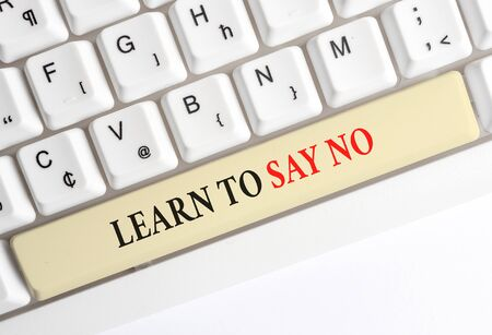 Writing note showing Learn To Say No. Business concept for decline or refuse few things before you destroy yourself White pc keyboard with note paper above the white background Stock Photo