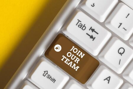 Conceptual hand writing showing Join Our Team. Concept meaning inviting someone to join in your local group or company White pc keyboard with note paper above the white background