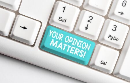 Conceptual hand writing showing Your Opinion Matters. Concept meaning show you do not agree with something that just been said White pc keyboard with note paper above the white background