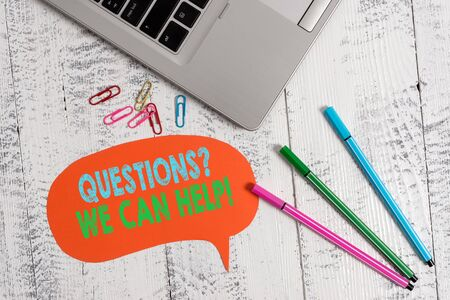 Handwriting text Questionsquestion We Can Help. Conceptual photo offering help to those who wants to know Trendy metallic laptop speech bubble colored clips pens lying vintage table