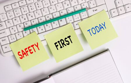 Word writing text Safety First. Business photo showcasing used to say that the most important thing is to be safe Three empty green square papers by the pc keyboard with copy space