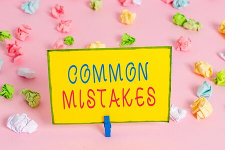Word writing text Common Mistakes. Business photo showcasing actions that are often used interchangeably with error Colored crumpled papers empty reminder pink floor background clothespin