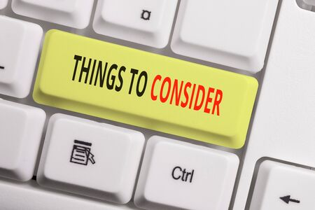 Text sign showing Things To Consider. Business photo showcasing think about carefully especially in making decisions White pc keyboard with empty note paper above white background key copy space 스톡 콘텐츠