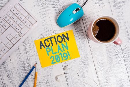 Conceptual hand writing showing Action Plan 2019. Concept meaning proposed strategy or course of actions for current year Technological devices colored reminder paper office supplies Banco de Imagens