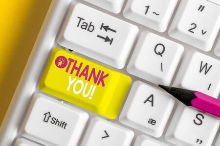 Text sign showing Thank You. Business photo showcasing polite expression used when acknowledging gift service compliment White pc keyboard with empty note paper above white background key copy space Banco de Imagens