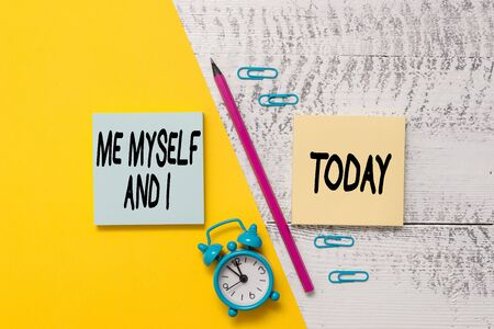 Word writing text Me Myself And I. Business photo showcasing used by speaker to refer to herself as the object of a verb Notepads marker pen colored paper sheet alarm clock wooden background