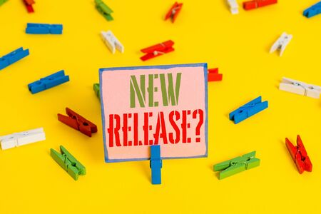 Word writing text New Release Question. Business photo showcasing asking about recent product or service newly unleashed Colored clothespin papers empty reminder yellow floor background office 스톡 콘텐츠