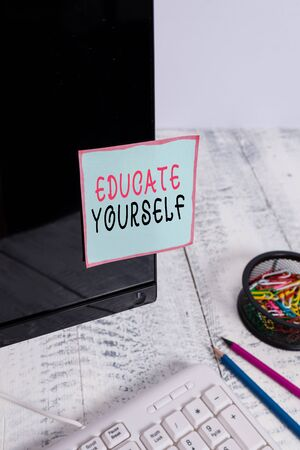 Word writing text Educate Yourself. Business photo showcasing prepare oneself or someone in a particular area or subject Note paper taped to black computer screen near keyboard and stationary